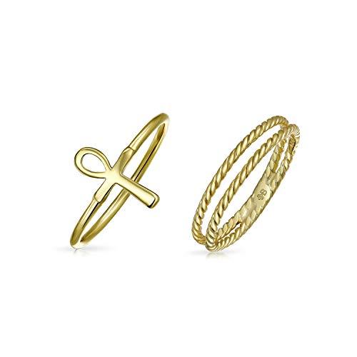 Este elegante deslizamiento cruz Ankh midi set anillos en los dedos y echar un vistazo a la moda de cada conjunto. La actualizada al minuto, aspecto de la cruz de Ankh brillante anillo apilable está en perfecto contraste con el diseño del cable trenz...