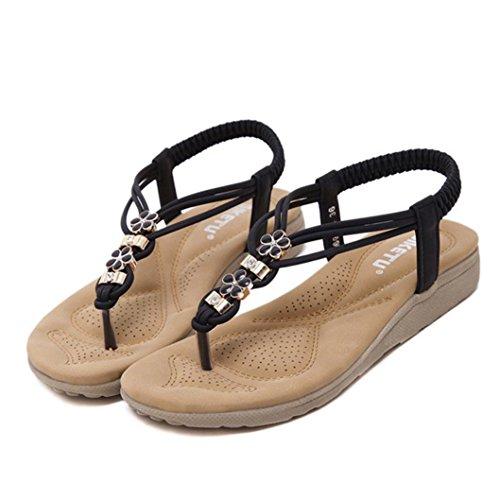 Transer® Damen Sandalen Flach Kunstleder+Gummi Blume Strass Wulstig Elastischer T-Gurt Schwarz Khaki Sandalen (Bitte achten Sie auf die Größentabelle. Bitte eine Nummer größer bestellen) Schwarz