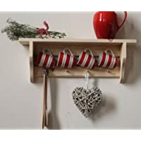 Natural pine shelf with a double rail of 8 Shakers peg