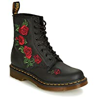 The 1460 Vonda boot makes a stylish update of the classic Dr. Martens 8 eyelets boots borrowing style from the 14-eye 1914 Vonda. Crafted from softy leather upper with embroidered roses cascading down the side of the boot. Complete with all t...
