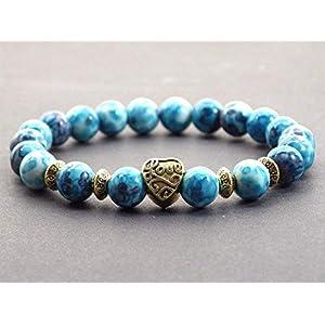Armband weißer Jade Perle blau getönt mit Gold Perle in Herzform