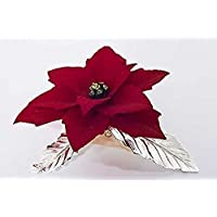 stella di natale fatta a mano in porcellana stile Capodimonte su foglie in peltro argentato