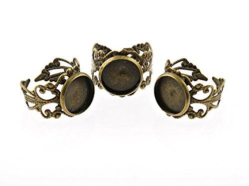 4 verzierte Ringrohlinge in antik Bronze mit Fassung für 12 mm Cabochons von Vintageparts,...