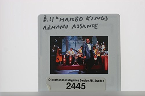 "Slides photo of Armand Assante in a scene from a 1992 French–American drama film, ""The Mambo Kings""."
