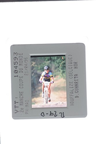 slides-photo-of-gunn-rita-dahle-flesja-riding-a-mountain-bike-in-the-tournament