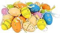 Uova di Pasqua colorate con gancio di nastro di seta come decorazione per Pasqua Uova di Pasqua in vari colori pastello e motivi con nastro per appendere arbusti, alberi, siepi e altro ancora.  I colori caldi e sorprendenti creano un'atmosfer...