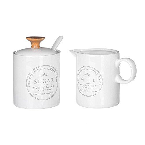 Ensemble sucrier avec cuillère et un petit pot blanc