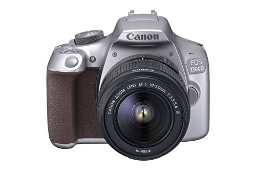 """Canon EOS 1300D - Cámaras réflex de 18 MP (pantalla de 3"""", DIGIC 4+, enfoque TTL-CT-SIR con un sensor CMOS, sistema AF en 9 puntos, NFT, WiFi), gris metalizado - kit con cuerpo y objetivo EF 18-55 DC"""