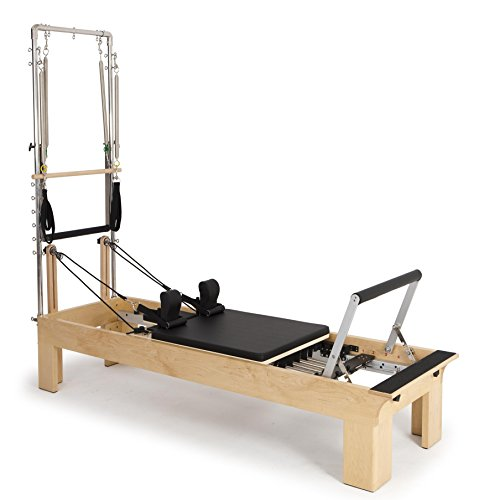 Elina pilates. reformer fisio in legno con torre - macchina pilates per professionisti. reformer sviluppato da esperti tecnici di pilates di tutto il mondo.