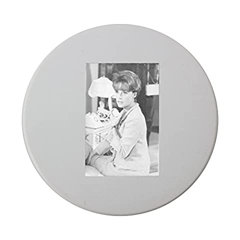 Ceramic round coaster with Jeanne Moreau holding phone receiver.