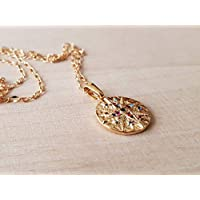 Necklace round medal cardinal points multicolored zircon