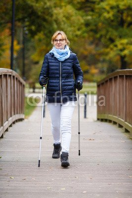 druck-shop24 Wunschmotiv: Nordic walking - middle-age woman working out in city park #120191634 - Bild auf Forex-Platte - 3:2-60 x 40 cm/40 x 60 cm