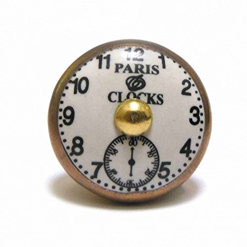 Pushka Home Paris Clock Face Gold Fixing Ceramic Cupboard Door Knob. 40mm novelty clock handle in a vintage style. Perfect to add brass metallic accents to your furniture doors. Suits doors up to 25mm thick. Opulent ornate look.