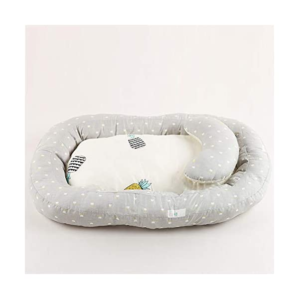 Moonvvin Portable Baby Lounger Breathable Hypoallergenic Co-Sleeping Baby Cot Bed Portable Crib for Bedroom/Travel  We use 100-percent cotton fabric and breathable, hypoallergenic internal filler, which is safe for baby's sensitive skin. It will give your child serene, safe, and sound sleep in their lovely co sleeping crib. Your child will feel comfortable and safe in our soft newborn lounger. Such a secure sleeper will allow your baby to have deep and nice sleep as little ones love the imitation of a stay in the mother's womb. It helps with common newborn sleep issues like wanting to sleep in a parent's arms or frequent waking. Use the infant lounger as a bassinet for a bed, side sleeper, travel bed, newborn pillow, changing station or move it around the house for lounging or tummy time, making baby feel more secure and cozy. The lightweight design and easy-to-use package with handle make our in bed bassinet a portable baby must-have. 6