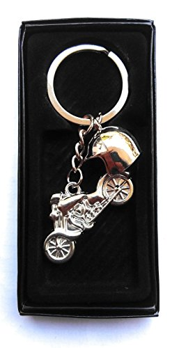 Bike and Helmet key chain rider studd metal key ring for bike car or Home  available at amazon for Rs.249