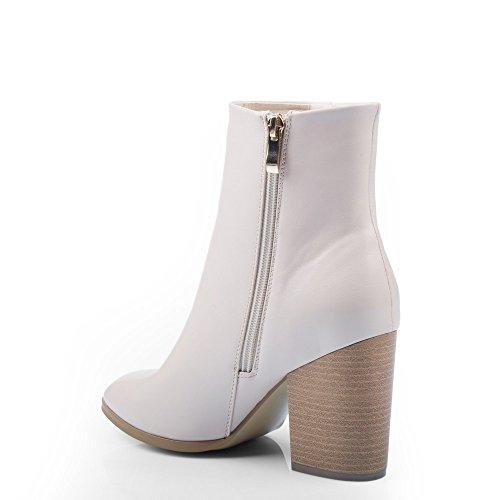 Ideal Shoes-Scarpette in simil pelle a Lama spessa con frange in Serra pelle Beige (Beige)