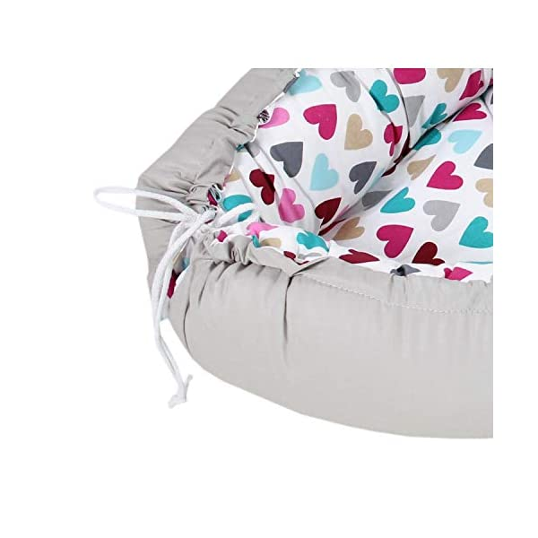 TupTam Baby Sleep Nest Portable Cuddle Nest - 2-sided, Colorful Hearts/Gray, c. 85 x 55 cm TupTam Multifunctional baby sleep nest in beautiful colour combinations - the perfect companion for a newborn baby The cuddly soft, breathable 100% cotton outer fabric and the filling made of anti-allergic polyester fleece ensure an optimal sleeping climate Thanks to the soft underlay and stable sides, the baby feels secure and is protected against uncontrolled rolling 3