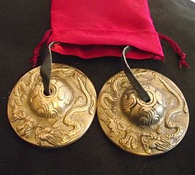 BEAUTIFUL TIBETAN BUDDHIST CHAKRA, TINGSHA CYMBALS, REIKI, SPACE CLEARING,MEDITATION AID; ON LEATHER CORD; 6cm DIAM. EMBOSSED WITH 2 AUSPICIOUS TIBETAN DRAGONS IN A RED SATIN DRAWSTRING CARRY POUCH, UNUSUAL GIFT IDEA - sold by Spiritual Gifts. Usually dispatched within 2 working