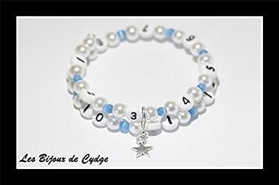Bracelet d'allaitement sur fil à mémoire de forme de 55mm avec perles en verre blanche et oeil de chat bleu claire