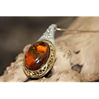 Silver and gold pendant. Celtic design amber pendant, gold and silver. Valentine's Day gift. Gold pendant. Amber jewelry. Handmade jewelry.