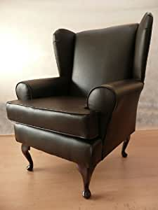 Brown faux leather Queen anne design wing back fireside high back chair. Ideal bedroom or living room furniture