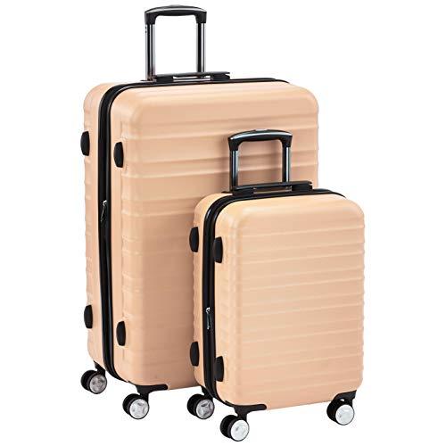 AmazonBasics - Juego de 2 maletas rígidas giratorias rosas prémium (51 cm, 71 cm)