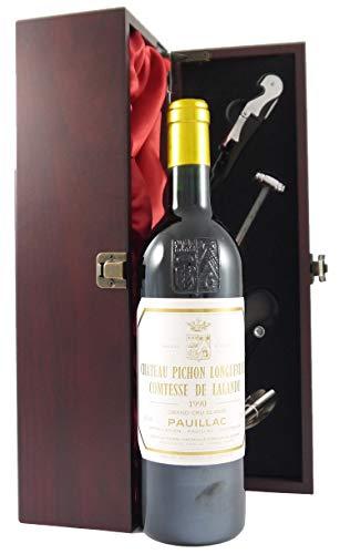 Chateau Pichon Longueville, Lalande 2eme Grand Cru Classe Pauillac 1990 75cl in einer mit Seide ausgestatetten Geschenkbox. Da zu vier Wein Zubehör, Korkenzieher ,Giesser ,Kapselabschneider ,Weinthermometer .