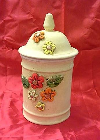 Jar récipient en céramique avec des fleurs colorées en relief.
