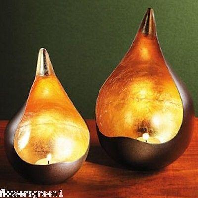 Portacandele in metallo con forma di lacrima in foglia d'oro Semplicemente sensazionale.[piccolo]