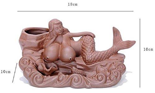 Material: arena púrpuraTecnología: semi-mecánica semi-mecánicaEmbalaje: embalaje de cartónNombre: quemador de incienso invertido Mermaid mintiendo