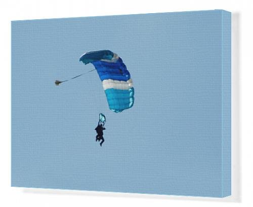 canvas-print-of-blue-parachute-in-blue-sky
