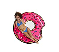 Gigantic Pink Donut Beach Blanket Nom Nom Nom Nom... Normally, drying off with a donut would create a sticky mess, but this humongous beach blanket will do the trick without having people question your sanity. At 5 feet wide, it makes a great...