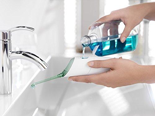 Philips Sonicare AirFloss Munddusche HX8255/02 – Zahnzwischenraumreinigung, Plaque-Entfernung & gesünderes Zahnfleisch - Alternative zu Zahnseide – Mit Etui, Düsenhalter & 3 Düsen – Weiß-grün