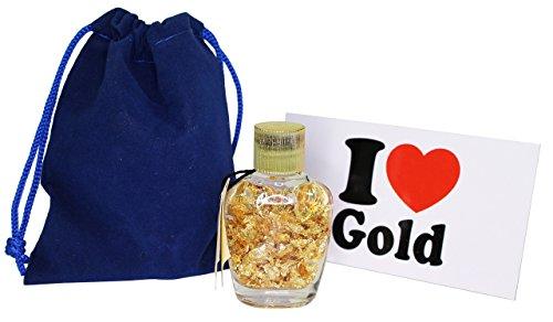 cristales-de-agua-color-azul-copos-de-oro-en-una-botella-pure-brasileo-de-24k-gold-rush-leafs-bolsa-