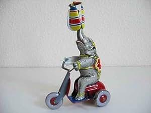 Éléphant avec moto de collection en métal