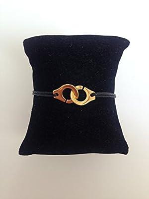 Bracelet menottes Dorées sur cordon satin