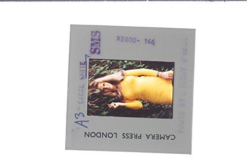 slides-photo-of-carol-white-striking-a-pose