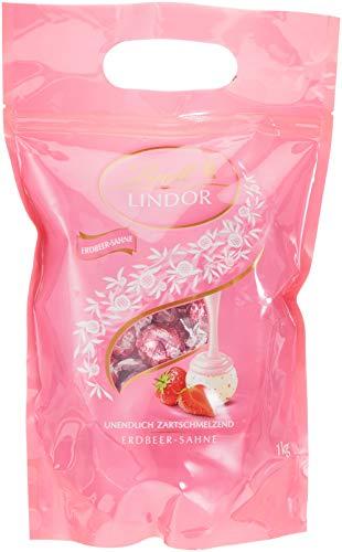 Lindt Lindor Beutel Erdbeer-Sahne, gefüllt mit Lindor Kugeln aus weißer Schokolade mit einer zartschmelzenden Erdbeer-Füllung, 1er Pack (1 x 1kg)