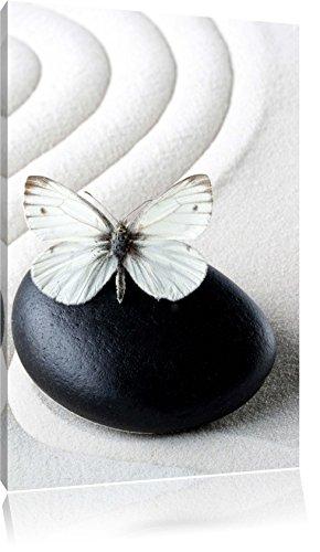 Pixxprint LFs7853_60x40 weißer Schmetterling auf Zen Steinen im Sand fertig gerahmt mit Keilrahmen...