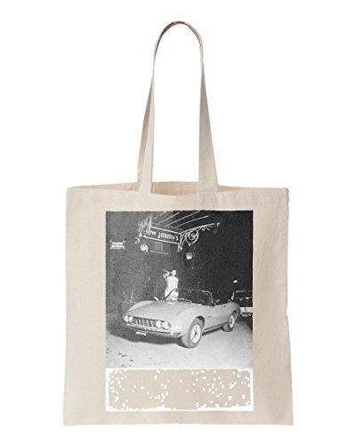 a-couple-looking-at-ferrari-dino-printed-tote-bag