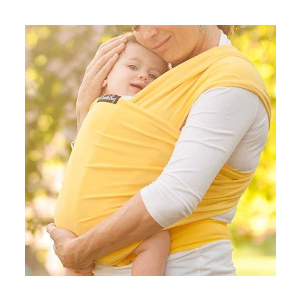 9-in-1 CuddleBug Baby Wrap Sling + Carrier - Newborns & Toddlers up to 36 lbs - Hands Free - Gentle, Stretch Fabric - Ideal for Baby Showers - One Size Fits All (Yellow) CuddleBug 9 WRAPS IN ONE - 9 different ways to comfortably carry your baby HANDS FREE! Newborn hold, breastfeed sling, front carry, side carry, back carry, cross carry, hip carry, kangaroo carry, side sling. GET THINGS DONE WHILE BONDING - Develop strong emotional bonds and constant stimulation with the flexibility and freedom to go where you want and get things done. COMFORTABLE AND SECURE - Support your baby in this MACHINE WASHABLE buckle-free, ring-free, Premium blend of 95% Cotton, 5% spandex. As gentle as wearing a T-shirt but strong enough to support your baby's head. 5