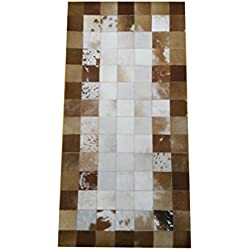 Zerimar. Alfombra piel de vaca en estilo patchwork. Medidas: 140x70 cms. Hecha a mano, colores naturales, sombreado único en cada bloque.