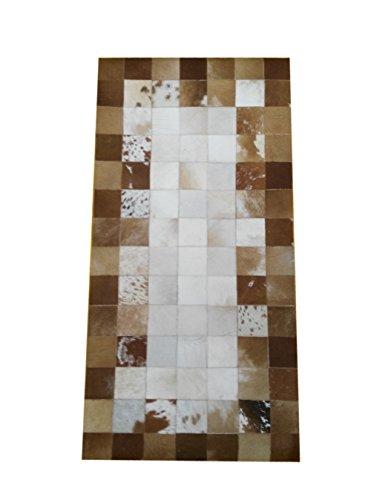 Tappeto pelle di mucca modello patchwork. Misure: 140x70 cms. Realizzato