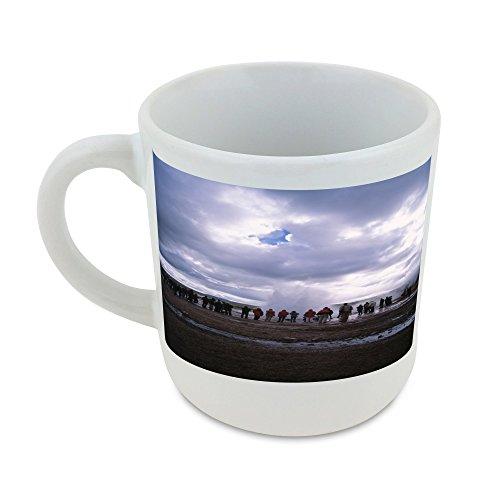 Mug with People gathering around an erupting geyser, cloudy sky