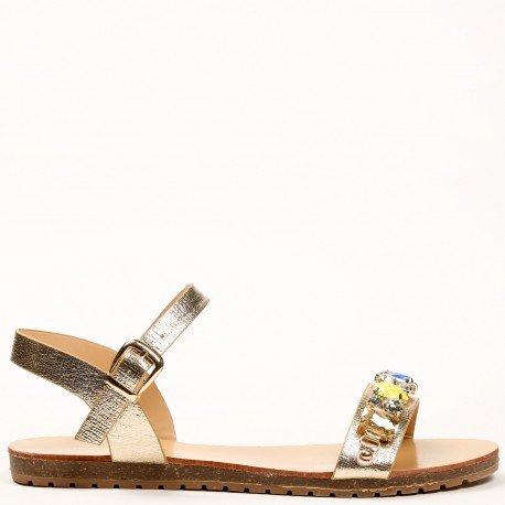 Ideal Shoes - Sandales plates effet pailleté avec lanière décorée de strass Vaea Doree