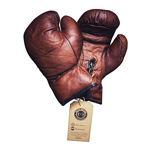 Guantes de boxeo retro de piel de 12 onzas, estilo retro único con un borde moderno. Estos guantes ofrecen múltiples usos si se trata de eventos profesionales de boxeador, decoración de interiores retro o entrenamiento de boxeo. ¿Por qué elegir los g...
