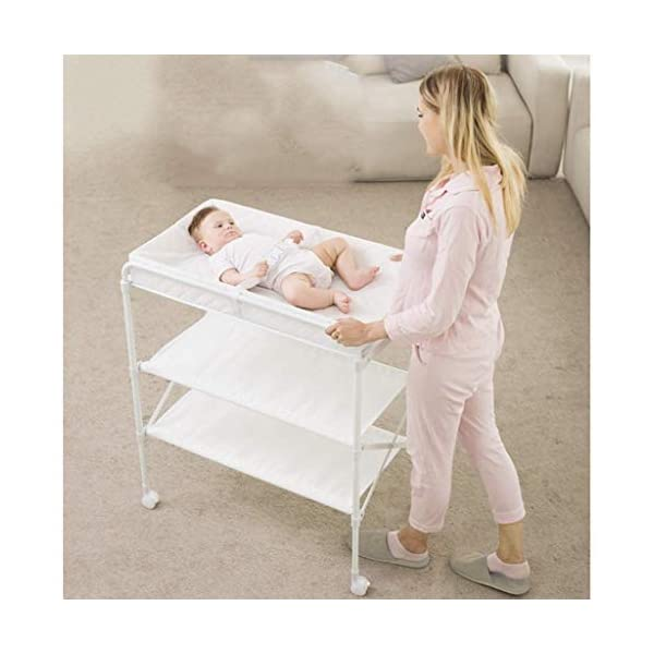 Changing Table Baby Changing Table Folding with Changing Mat Nursery Diaper Care Organizer Baby Changing Station for Baby Bath with Tube Changing Table ●Size and Safe and Stable- 85 x 50 x 132cm,Suitable for babies weighing less than 25kg,With seat belt,Changing pad has a restraining strap for added safety and is made of easy to clean, soft ●2-in-1 design- Baby changing table can be used as baby massaging table as well. It is designed at the proper height of parent to prevent mom's back aches and pains from kneeling or bending when changing diapers to babies. ●Premium materials - Using high-quality materials for our 2 in 1 infant changing table,Reinforced wood,it is durable and stable for long time daily use,And easy to clean and maintain. 4