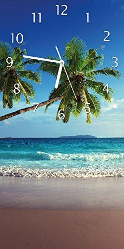Wallario Design Wanduhr Sandstrand auf den Seychellen - Urlaub unter Palmen aus Acrylglas, Größe 30 x 60 cm
