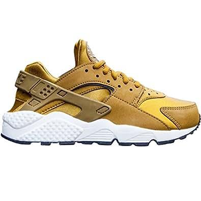 Nike Women's Wmns Air Huarache Run Sneakers gold Size: 3.5 UK