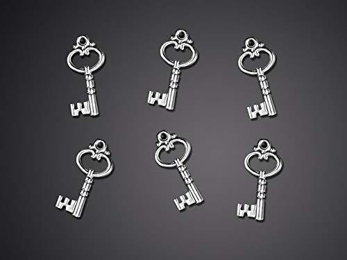 Stock 25 pezzi applicazione decorazione bomboniera a forma di chiave silver